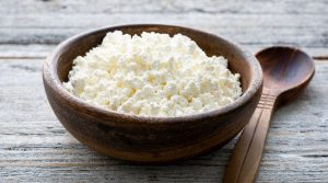 Wooden-Bowl-and-Spoon-With-Crumbly-Cheese